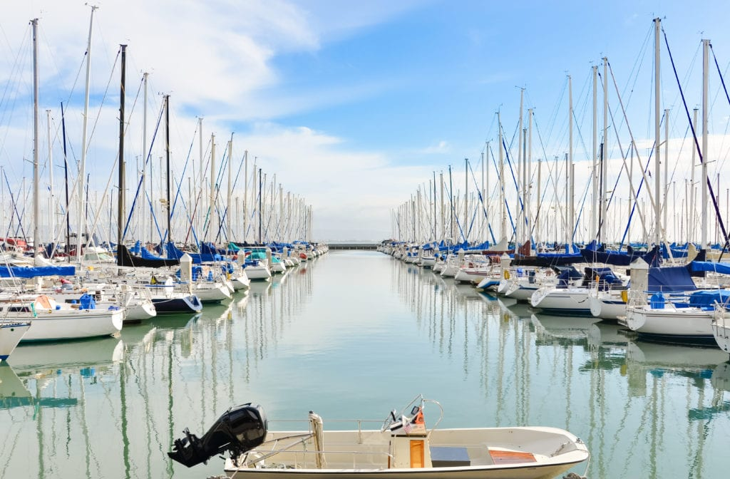 sailboats lined up in bayside docks aross from bayside village
