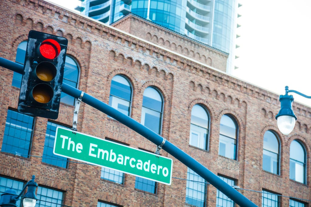 street sign for the embarcadero in san francisco across from bayside village