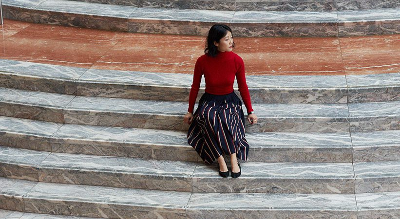 Alice Gao sitting on marble steps in BFPLNY